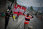 "© Remi OCHLIK/IP3 - Port au Prince on 2010 december 9 - PORT-AU-PRINCE -- Clashes and shooting were reported Thursday in Haiti's capital for a second day as demonstrators staged a march to protest what they said was election fraud in the Nov. 28 presidential elections..The protests broke out Wednesday after election officials announced Tuesday night that two candidates had made it into a runoff: Mirlande Manigat, a former first lady, and Jude CÈlestin, the candidate of current President RenÈ PrÈval's party. Out of the running was Michel ""Sweet Micky'' Martelly, who early results had shown running second. -  Haitian policemen try to remove roadblocks in delmas neighborhood."