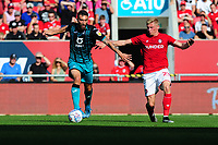 Borja Baston of Swansea City vies for possession with Taylor Moore of Bristol City during the Sky Bet Championship match between Bristol City and Swansea City at Ashton Gate in Bristol, England, UK. Saturday 21 September 2019