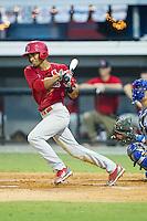 Oscar Mercado (4) of the Johnson City Cardinals follows through on his swing against the Burlington Royals at Burlington Athletic Park on July 14, 2014 in Burlington, North Carolina.  The Cardinals defeated the Royals 9-4.  (Brian Westerholt/Four Seam Images)