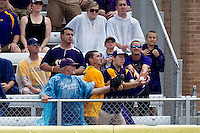 LSU fans reach for Stony Brook first baseman Kevin Courtney's home run during the NCAA Super Regional baseball game against Stony Brook on June 9, 2012 at Alex Box Stadium in Baton Rouge, Louisiana. Stony Brook defeated LSU 3-1. (Andrew Woolley/Four Seam Images)