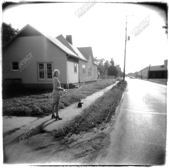 Reporter with out a cameraman in a Terre Haute neighborhood the day of Timothy McVeigh's execution. Terre Haute, Indiana, USA, June 2001.