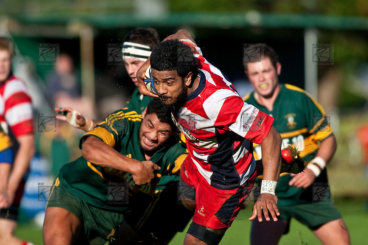 Reynold Lee-Lo make a break past the tackle of Maama Viapulu. Counties Manukau Premier Club Rugby game between Pukekohe & Karaka played at Colin Lawrie Fields Pukekohe on Saturday May22nd 2010..Pukekohe won the game 32 -28 after trailling 3 - 22 at halftime.