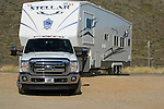 2011 Ford Super Duty towing 5th wheel trailer.