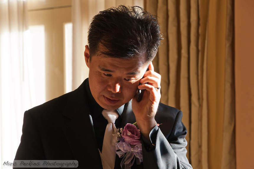 What would a modern groom be if he wasn't on a cell phone less than half an hour after his wedding?
