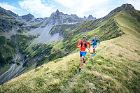 Trail running on a grassy mountain trail above the Weisstannental, near the Pizol, Switzerland