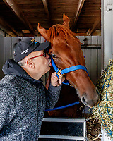 LOUISVILLE, KENTUCKY - MAY 02: Majority owner Salomón Del Valle kisses Gunnevera in his stall at Churchill Downs on May 2, 2017 in Louisville, Kentucky. (Photo by Jesse Caris/Eclipse Sportswire/Getty Images)