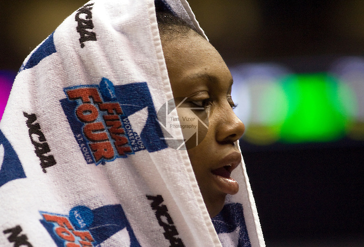 040709TVWOMENSFINALFOUR23.Louisville's Deseree Byrd draped a towel over her head after she fouled out late in the second half of the NCAA Women's Final Four Championship game against UConn at the Scottrade Center in St. Louis, MO on Tuesday April 7, 2009.  UConn defeated Louisville, 76-54..MCT/TIM VIZER