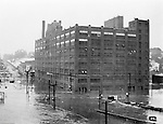 Pittsburgh PA:  A view of a building on the North Side near the Western Penitentiary during the great Pittsburgh flood - 1936.