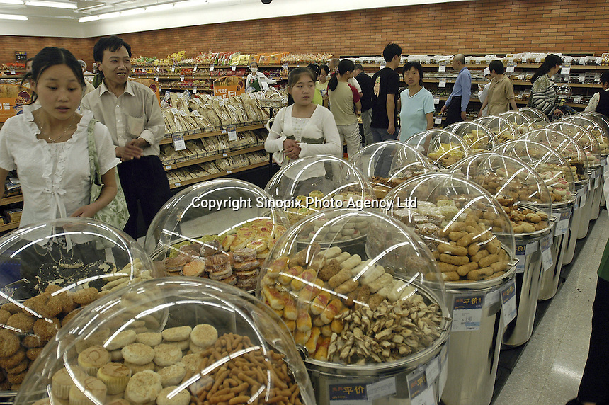 cakes in the first supercenter of Wal-Mart in Beijing, China..18 May 2005