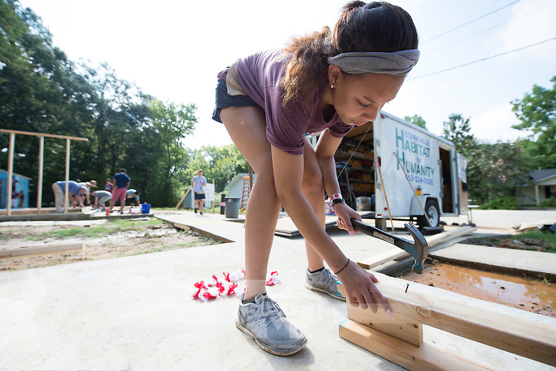 Service DAWGS Day: MSU student volunteer Cheyelle Chatman works at Habitat for Humanity Maroon Edition house.<br />