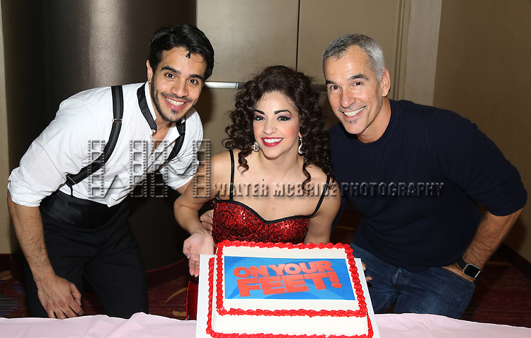 Ektor Rivera and Ana Villafañe with director Jerry Mitchell of the Broadway production of 'On Your Feet!' celebrate their 500th performance at Marquis Hotel  on January 18, 2017 in New York City.