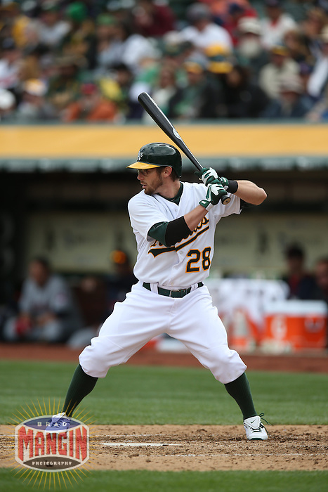 OAKLAND, CA - APRIL 2:  Eric Sogard #28 of the Oakland Athletics bats against the Cleveland Indians during the game at O.co Coliseum on Wednesday, April 2, 2014 in Oakland, California. Photo by Brad Mangin