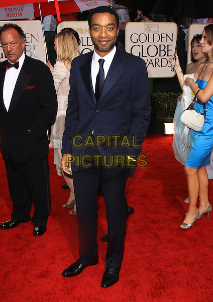 CHIWETEL EJIOFOR.67th Golden Globe Awards held Beverly Hilton, Beverly Hills, California, USA..January 17th, 2010.globes full length black blue suit hand in pocket.CAP/ADM/KB.©Kevan Brooks/Admedia/Capital Pictures