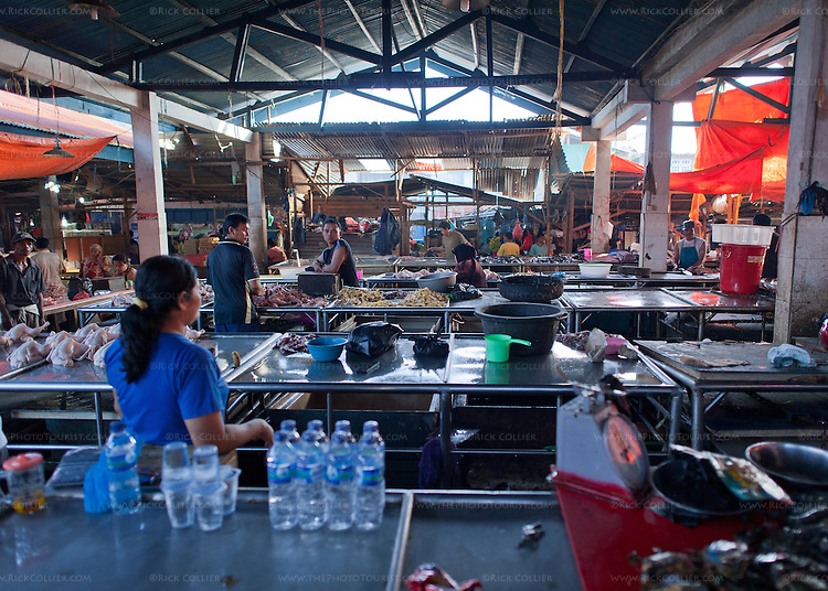 City-provided stainless tables are arrayed in rows inside the open-air market in Bitung City, North Sulawesi, Indonesia.