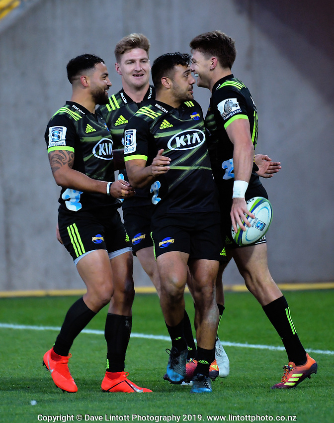 The Hurricanes celebrate Beauden Barrett's try during the Super Rugby match between the Hurricanes and Rebels at Westpac Stadium in Wellington, New Zealand on Saturday, 4 May 2019. Photo: Dave Lintott / lintottphoto.co.nz
