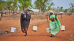 Krima Mangi (left) and Aisha Albaqir carry water in the Kaya Refugee Camp in Maban County, South Sudan. The camp shelters thousands of refugees from the Blue Nile region of Sudan, including these two women, and Jesuit Refugee Service, with support from Misean Cara, provides educational and psycho-social services to both refugees and the host community.