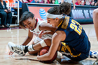 STANFORD, CA-JANUARY 28, 2011: Amber Orrange looks for a loose ball during a 74-71 overtime win over the Cal Bears.