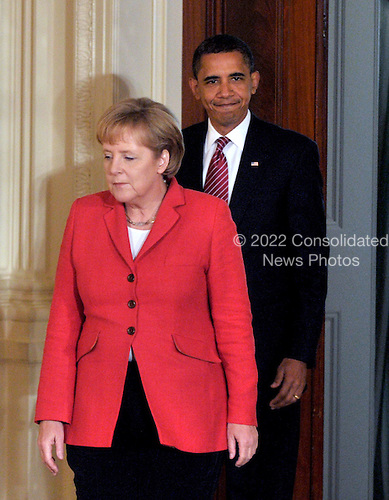 Washington, D.C. - June 26, 2009 -- United States President Barack Obama and Chancellor Angela Merkel of Germany arrive in the East Room of the White House in Washington, D.C.to hold a joint press conference on Friday, June 26, 2009..Credit: Ron Sachs / CNP