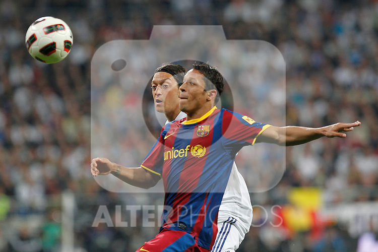 Real Madrid's Mesut Ozil and FC Barcelona's Adriano during la Liga match on April 16th 2011...Photo: Cesar Cebolla / ALFAQUI