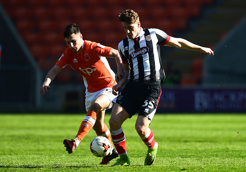 Blackpool's Jordan Flores competes with Grimsby Town's Sam Jones<br /> <br /> Photographer Richard Martin-Roberts/CameraSport<br /> <br /> The EFL Sky Bet League Two - Blackpool v Grimsby Town - Saturday 8th April 2017 - Bloomfield Road - Blackpool<br /> <br /> World Copyright &copy; 2017 CameraSport. All rights reserved. 43 Linden Ave. Countesthorpe. Leicester. England. LE8 5PG - Tel: +44 (0) 116 277 4147 - admin@camerasport.com - www.camerasport.com