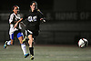 Suffolk Team No. 29 Rachel Suarez (Shoreham-Wading River HS), right, chases after a loose ball with Nassau No. 3 3 Stephanie Carcamo (West Hempstead HS) in tow during the second of two Long Island varsity girls' soccer senior all-star games at Bethpage High School on Friday, November 27, 2015.<br /> <br /> James Escher