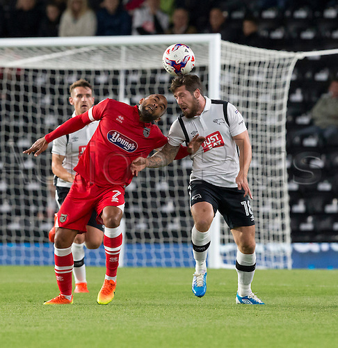 09.08.2016. iPro Stadium, Derby, England. Football League Cup 1st Round. Derby versus Grimsby Town. Derby County midfielder Jacob Butterfield and Grismby Town midfielder Ben Davies challenge for the header