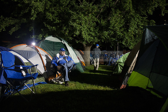 Lifelong UK fan Mike McFarland waits outside Memorial Coliseum for his seventh consecutive year in Lexington, Ky., on Wednesday, September 17, 2014. McFarland, originally from southern Ohio, has been coming to Memorial Coliseum each year since he retired. Photo by Adam Pennavaria | Staff