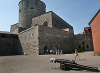 The inside courtyard at Carlsten Fort  which sits on a small island called Marstrand. Old gun in foreground.