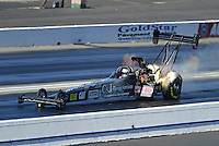 Nov. 10, 2012; Pomona, CA, USA: NHRA top fuel dragster driver Bob Vandergriff Jr has a small fire during qualifying for the Auto Club Finals at at Auto Club Raceway at Pomona. Mandatory Credit: Mark J. Rebilas-
