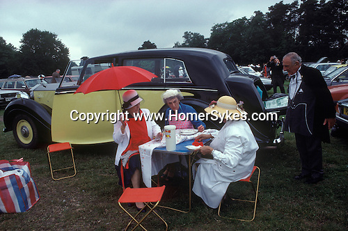 Royal Ascot, picnic in car park No 1. Berkshire England. The English Season published by Pavilion Books 1987. Page 89. <br />