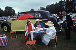 Royal Ascot, picnic in car park No 1. Berkshire England. The English Season published by Pavilion Books 1987. Page 89. Yellow Rolls Royce.