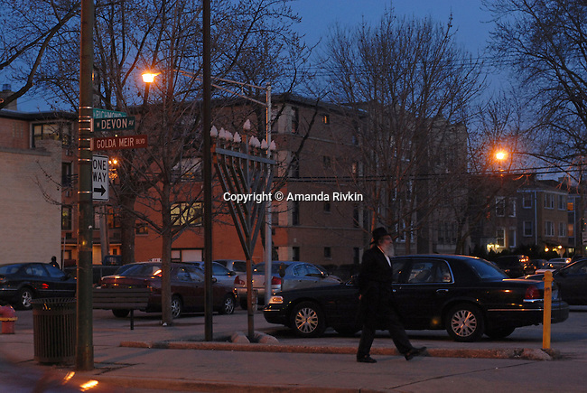 An Orthodox Jewish man on West Devon Avenue or Honorary Golda Meir Way in the West Rogers Park neighborhood of Chicago on April 5, 2008.  Indian, Pakistani, Muslim and Jewish, Devon Avenue in the West Rogers Park neighborhood is an eclectic representation of the world.