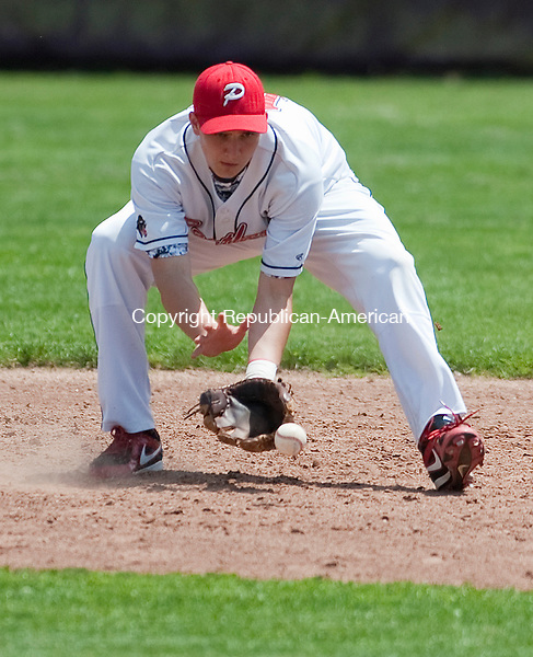 SOUTHBURY, CT-052614JS22--Pomperaug's Grant Wallace (15) fields a ground ball during their SWC tournament game against Masuk Monday at Pomperaug High School in Southbury. <br /> Jim Shannon Republican-American