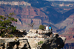 COUPLE PERCH PRECARIOUSLY on LEDGE at the GRAND CANYON<br />