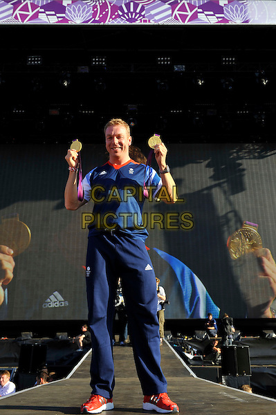 Sir Chris Hoy .BT London Live, Hyde Park, London, England. .8th August 2012.full length blue t-shirt joggers medals arms in air winner medals .CAP/MAR.© Martin Harris/Capital Pictures.