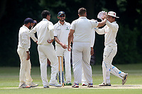 J Lord of Wanstead is congratulated by his team mates after taking the wicket of S Prabhakar during Wanstead and Snaresbrook CC vs Ilford CC, Shepherd Neame Essex League Cricket at Overton Drive on 17th June 2017