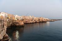 Italy, Puglia, Polignano a mare, dusk at seaside