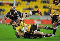 Cory Jane is brought down by Marcell Coetzee (top) and Sibusiso Sithole during the Super Rugby match between the Hurricanes and Sharks at Westpac Stadium, Wellington, New Zealand on Saturday, 9 May 2015. Photo: Dave Lintott / lintottphoto.co.nz
