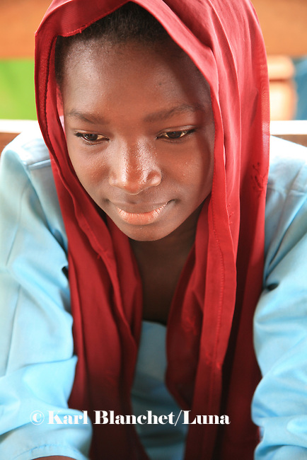 A young girl in a classroom of the Islamic school in Sunyani, Ghana, praying at the mosque. In Ghana, coranic schools were transformed into islamic schools. Pupils learn the mainstream curriculum and have additional courses in arabic and islam.