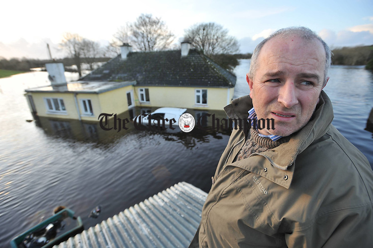 Hugh O Donnell returns to survey damage at the family home in Beagh, Gort, from the roof of his fooded abbatoir. His family, including his 87 year old mother Mary, were air lifted by Shanon Rescue helicopter from the house. Photograph by John Kelly.