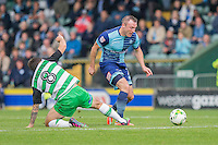 Garry Thompson of Wycombe Wanderers gets past Alex Lawless of Yeovil Town during the Sky Bet League 2 match between Yeovil Town and Wycombe Wanderers at Huish Park, Yeovil, England on 8 October 2016. Photo by Mark  Hawkins / PRiME Media Images.