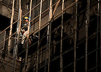 111229-N-DR144-638 HONG KONG (Dec. 29, 2011) A construction worker erects bamboo scaffolding in Kowloon, Hong Kong. (U.S. Navy photo by Mass Communication Specialist 2nd Class James R. Evans/Released)