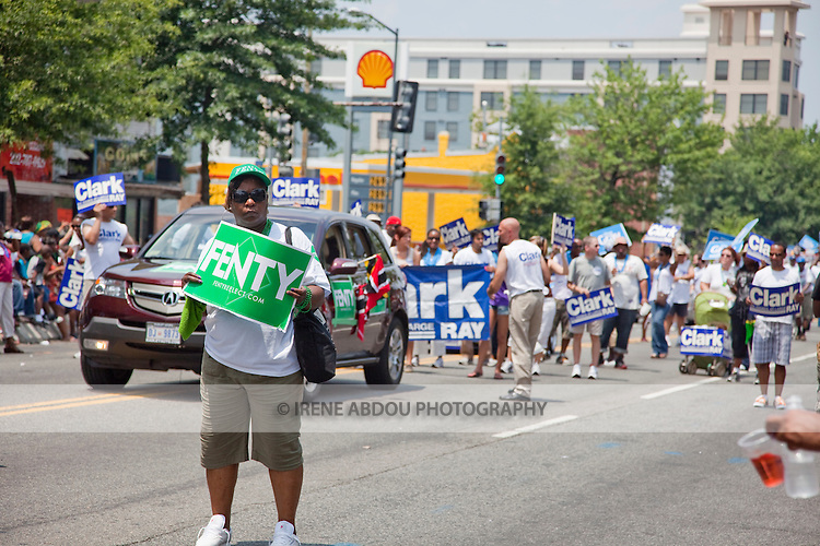 Supporters of Mayor Adrian M. Fenty - followed by campaigners for Ray Clark - head up the parade at the 2010 DC Caribbean Carnival in Washington, DC.