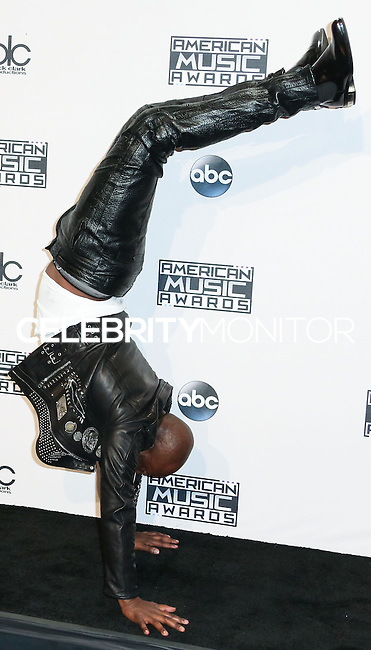 LOS ANGELES, CA, USA - NOVEMBER 23: Wyclef Jean poses in the press room at the 2014 American Music Awards held at Nokia Theatre L.A. Live on November 23, 2014 in Los Angeles, California, United States. (Photo by Xavier Collin/Celebrity Monitor)