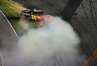 Jul. 5, 2008; Daytona Beach, FL, USA; NASCAR Sprint Cup Series driver Jeff Gordon spins during the Coke Zero 400 at Daytona International Speedway. Mandatory Credit: Mark J. Rebilas-
