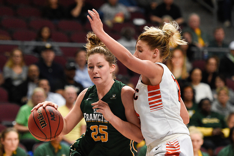March 5, 2015; Las Vegas, NV, USA; San Francisco Dons forward Alicia Scafidi (25) dribbles the basketball against Pacific Tigers guard Madison Parrish (11) during the second half of the WCC Basketball Championships at Orleans Arena.