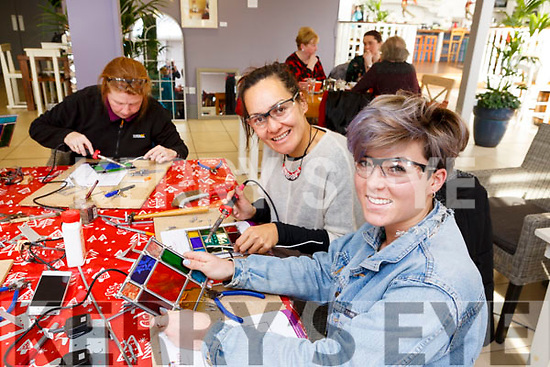 Creating Stain Glass pieces at the Mary J. Leen Stained Glass workshop in the Ballyseedy Garden Centre on Friday last. L-r, Valerie Barry (Co Cork), Roimata Harmon (Killorglin) and Jodie Mahony (Ballyheigue).
