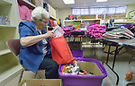Sister Jo Murray helps assemble backpacks and bags of personal items for women and children who've been released from immigration detention facilities in Texas. The women have fled violence in Central America with their children and were detained by immigration authorities upon their arrival in the United States. After being released in San Antonio, they travel onward to stay with relatives elsewhere in the U.S., pending a final decision on their request for asylum. <br /> <br /> The backpacks and bags are assembled at El Divino Salvador United Methodist Church in San Antonio. The project is sponsored by the Interfaith Welcome Coalition. Murray, a Roman Catholic, is a member of the Holy Spirit Sisters.