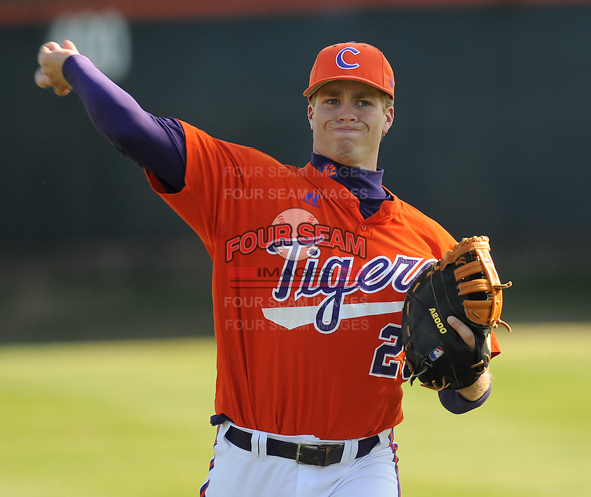 RHP Richard Mounce (20) warms up prior to a game between the Charlotte 49ers and Clemson Tigers Feb. 20, 2009, at Doug Kingsmore Stadium in Clemson, S.C. (Photo by: Tom Priddy/Four Seam Images)