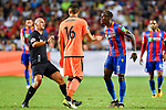 Referee Bobby Madley (L) in action as Crystal Palace midfielder Wilfried Zaha (R) confronts with Liverpool FC midfielder Marko Grujic (C) during the Premier League Asia Trophy match between Liverpool FC and Crystal Palace FC at Hong Kong Stadium on 19 July 2017, in Hong Kong, China. Photo by Weixiang Lim / Power Sport Images